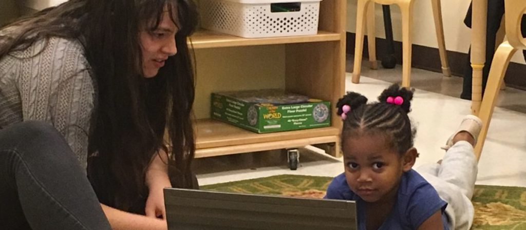 Student observing a child at The Early Learning Center