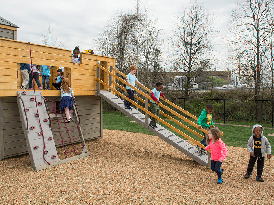 Students climbing playground at the Early Learning Center