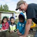 New Castle County Master Gardeners work with students at UD's Early Learning Center.