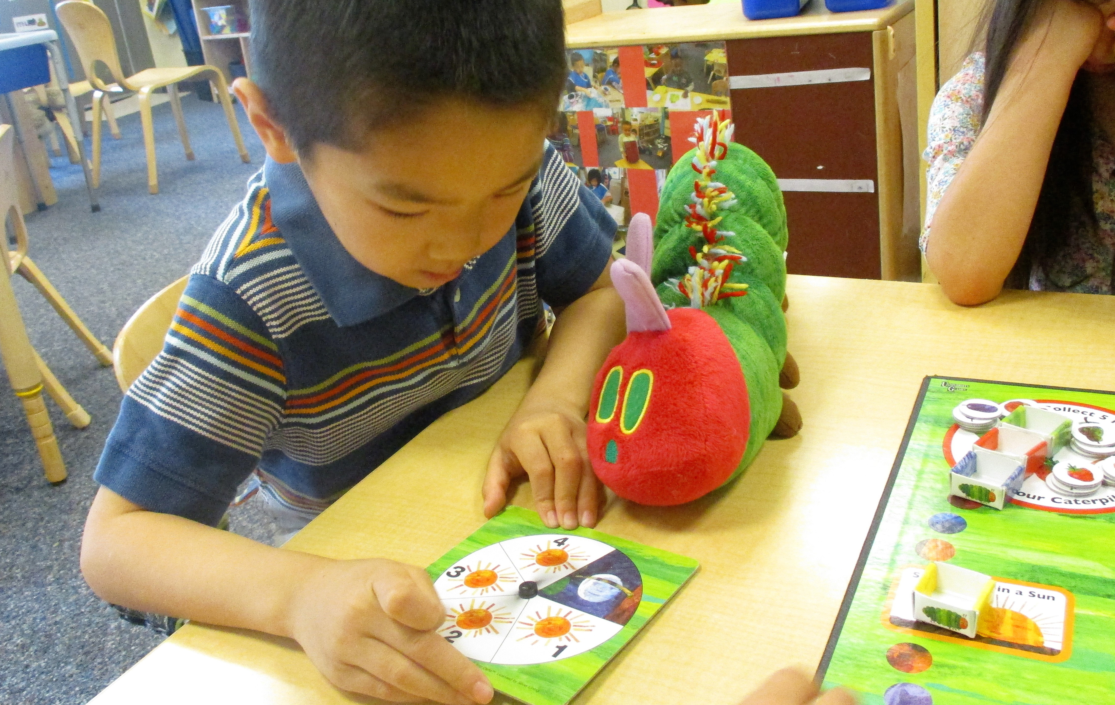 Student plays educational game in classroom at the Early Learning Center