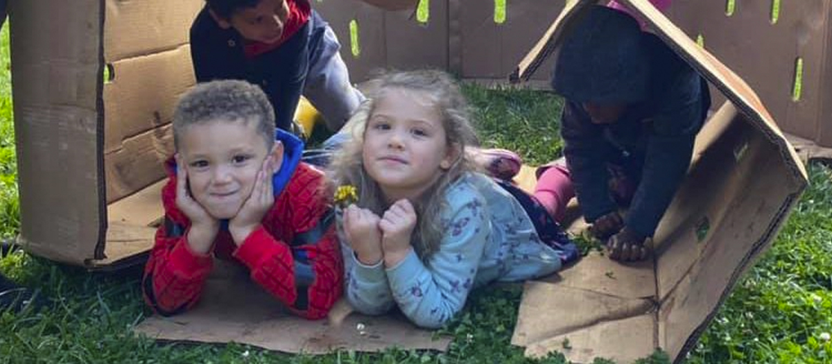Two preschool children playing outside at the Early Learning Center